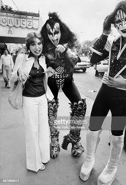 Kiss Rock band Group Gene Simmons in New York City Alison Steele a rock disc jockey frolics with them