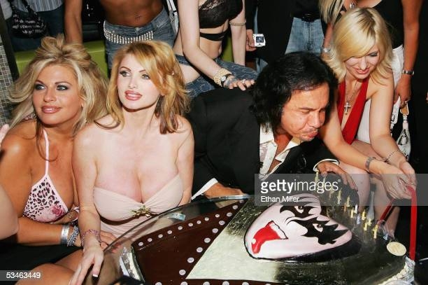 Kiss singer/bassist Gene Simmons blows out the candles on his birthday cake during his birthday party at the Ghostbar at the Palms Casino Resort...