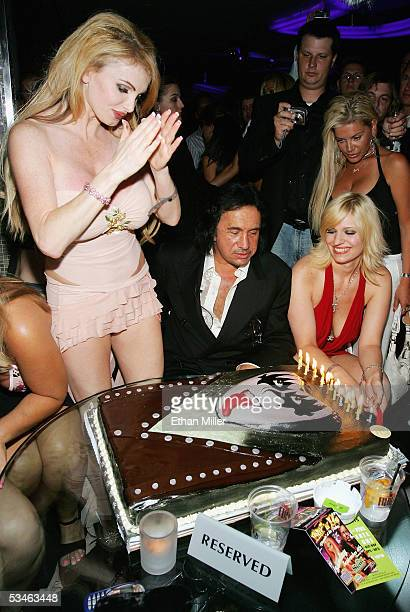 Kiss singer/bassist Gene Simmons checks out his birthday cake as adult film actress Taylor Wane looks on during his birthday party at the Palms...