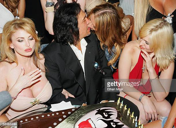 Kiss singer/bassist Gene Simmons kisses a guest during his birthday party at the Palms Casino Resort August 25 2005 in Las Vegas Nevada Adult film...