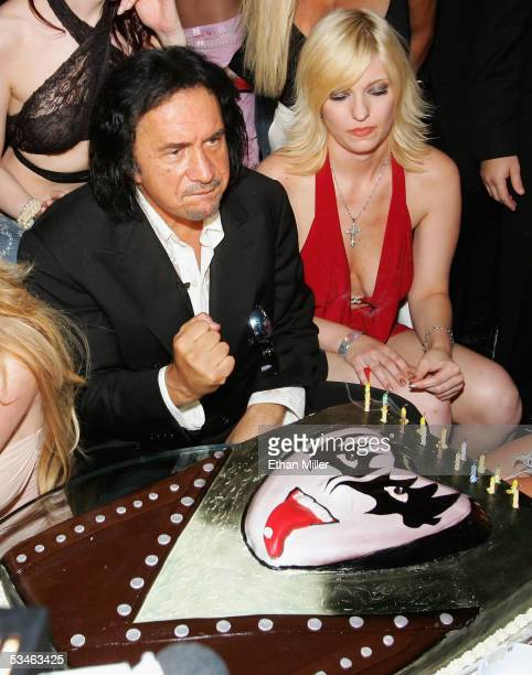 Kiss singer/bassist Gene Simmons pumps his fist after blowing out the candles on his birthday cake during his birthday party at the Ghostbar at the...