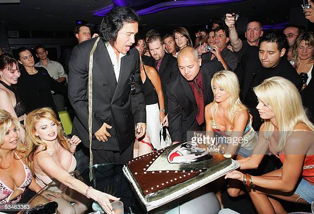 Kiss singer/bassist Gene Simmons reacts as his birthday cake arrives during his birthday party at the Ghostbar at the Palms Casino Resort August 25...
