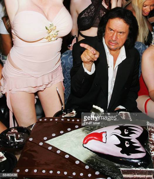 Kiss singer/bassist Gene Simmons sitting next to adult film actress Taylor Wane gestures during his birthday party at the Ghostbar at the Palms...