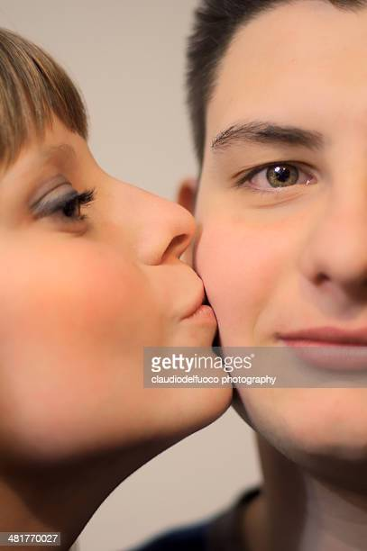 kiss to cheek - hazel bond stock photos and pictures