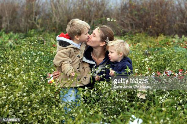 A kiss under the mistletoe for mother Sidone Allsop from her son Edward and William 18 months old The trio from nearby Brimfield were attending...