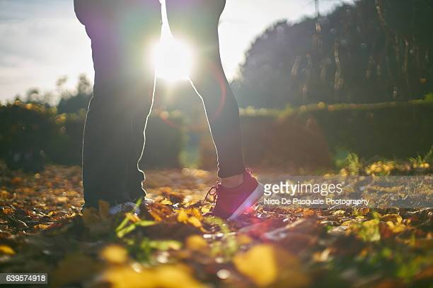 kissed by the sun - leg kissing stock photos and pictures