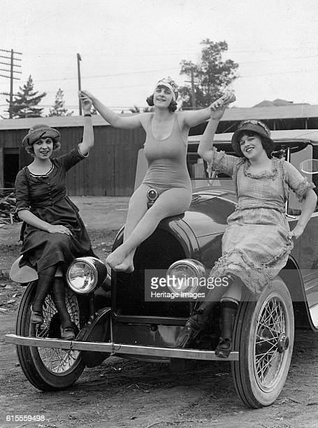 Kissel 6 circa 1922 with ladies on car. Artist Unknown.