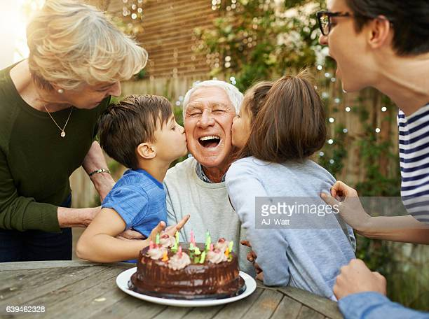 kisses for the birthday boy - multigenerational family stock photos and pictures