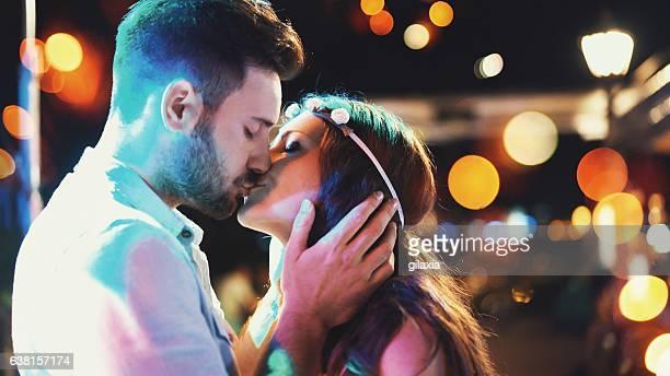 Kissing at a party.