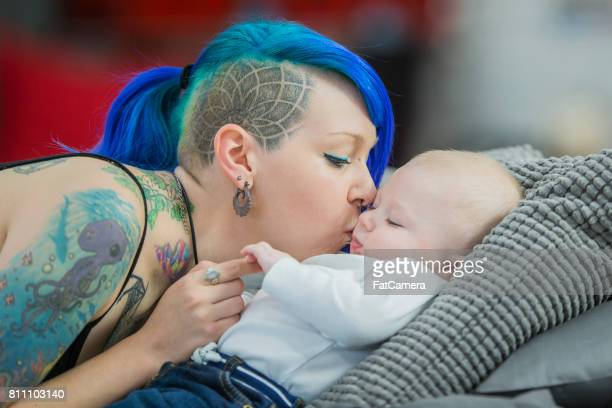kissing baby - alternative lifestyle stock pictures, royalty-free photos & images