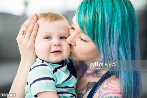 kissing baby - blue hair stock pictures, royalty-free photos & images