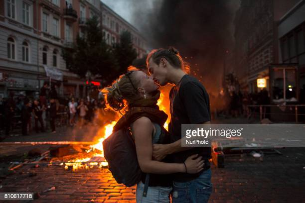 Kissing couple during riots in St Pauli district during G 20 summit in Hamburg on July 8 2017 Authorities are braced for largescale and disruptive...