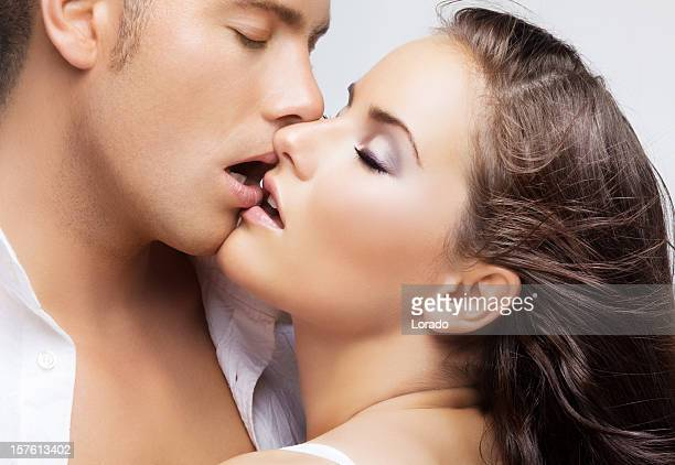 kissing couple - pretty girls stock photos and pictures