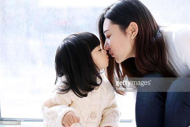 kissing daughter