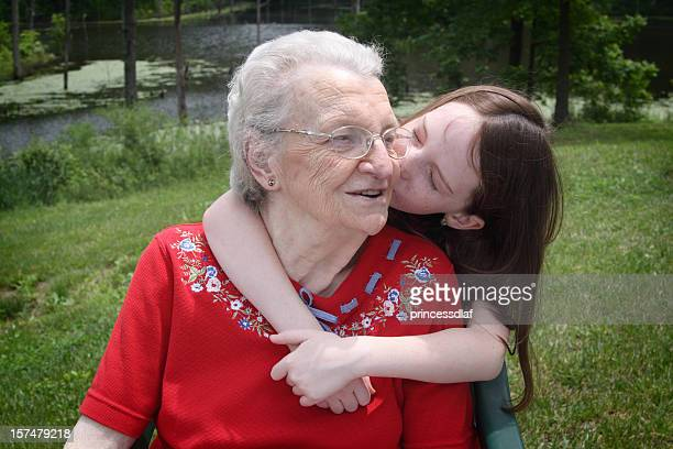 kissing great grandma - great granddaughter stock photos and pictures