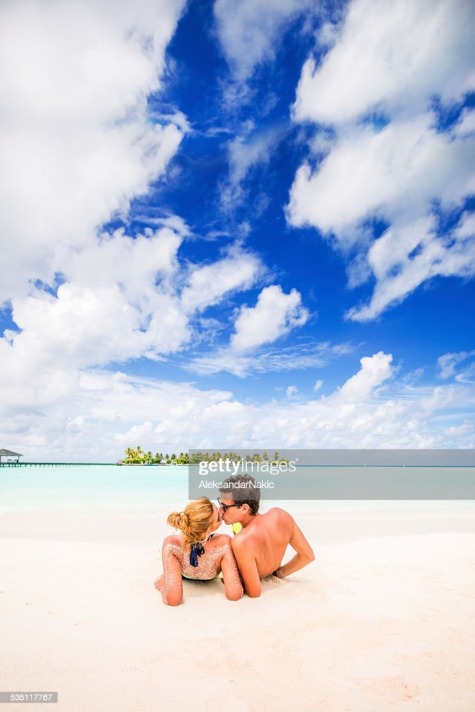 Kissing in the tropical paradise : Stock Photo