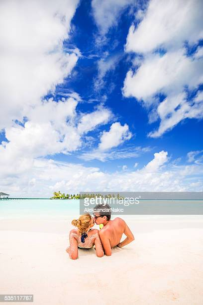 kissing in the tropical paradise - heterosexual couple photos stock photos and pictures