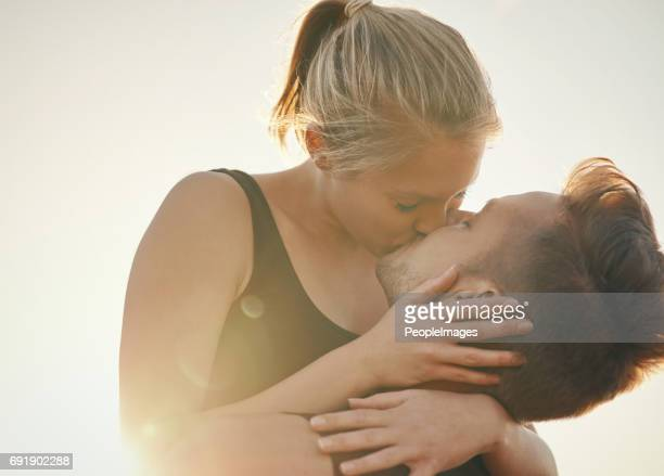 kissing is a great calorie burner - kissing on the mouth stock photos and pictures