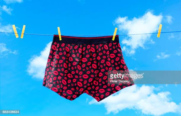 kissing lips on boxer shorts on a washing line - shorts stock pictures, royalty-free photos & images