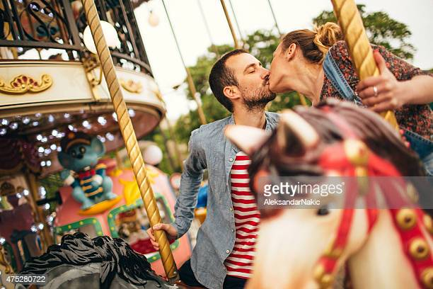 Kissing on the carousel ride
