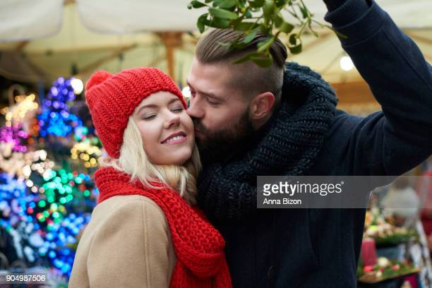 kissing under the mistletoe is a tradition. cracow, poland - mistletoe stock photos and pictures