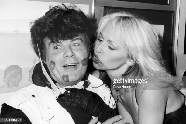 Kissogram girl, Sue Scadding kisses singer Gary Glitter, circa 1980s.