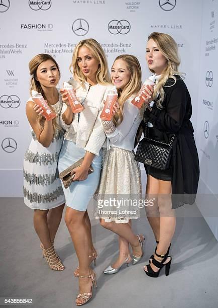Kisu Carmen Mercedes Diana zu Loewen and Kristina Derichs are seen with Quickacap bottles during the MercedesBenz Fashion Week Berlin Spring/Summer...