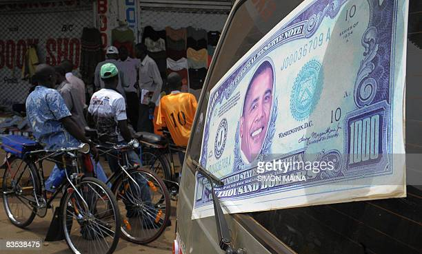 Kisumu cyclist stand as they wait on November 3 2008 for clients outside a supermarket as a van drives past with the portrait of US Democratic...