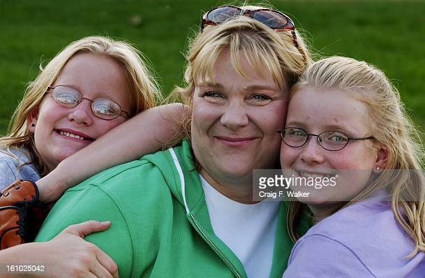Kit Addleman poses for a portrait with her twin 11yearold daughters Libby left and Ginny Husband and father Frank Addleman was called to duty with...