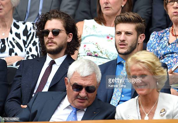 Kit Harington and Adam Lallana attend the Christina McHale v Sabine Lisicki match on day four of the Wimbledon Tennis Championships at Wimbledon on...