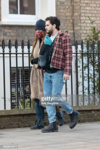 Kit Harington and Rose Leslie seen with their baby boy on a walk in North London on February 24, 2021 in London, England.