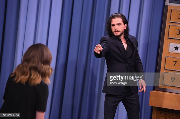 Kit Haringtonplays a game of 'Charades' during a taping of 'The Tonight Show Starring Jimmy Fallon' at Rockefeller Center on May 13 2016 in New York...