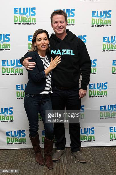 APPLY Kit Hoover and Billy Bush pose for photos during 'The Elvis Duran Z100 Morning Show' at Z100 Studio on September 23 2014 in New York City