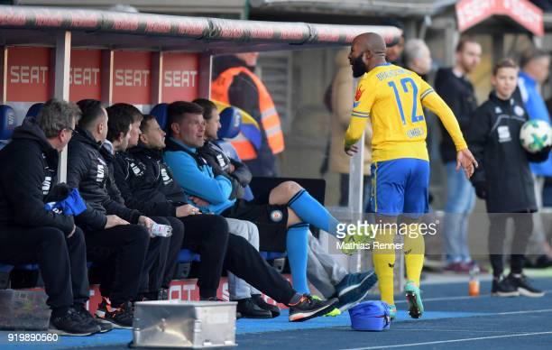 Kit manager Christian Skolik physiotherapist Goce Janevski and Domi Kumbela of Eintracht Braunschweig during the second Bundesliga match between...