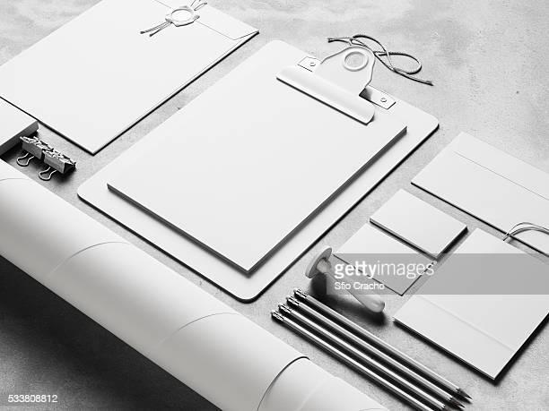 Kit of white blank identity elements on concrete background