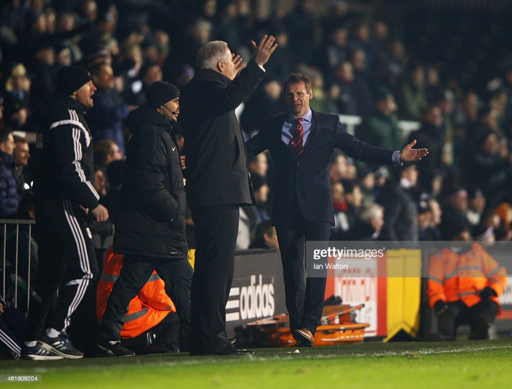 Kit Symons manager of Fulham and Stuart Pearce manager of Nottingham Forest react during the Sky Bet Championship match between Fulham and Nottingham Forest at Craven Cottage on January 21, 2015 in London, England.