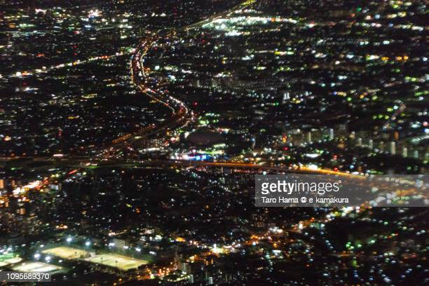 Kita-Ku of Osaka city in Osaka prefecture in Japan night time aerial view from airplane