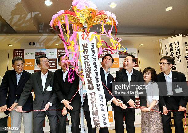 Kitakyushu City Mayor Kenji Kitahashi and city officers celebrate the Yawata Steel Works are registered as world heritage site at Kokura Kita Ward...