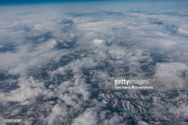 Kitashiobara village in Fukushima prefecture and Yonezawa city in Yamagata prefecture in Japan daytime aerial view from airplane