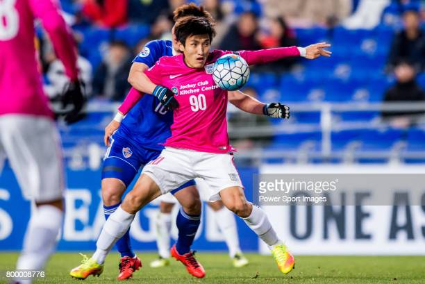 Kitchee Defender Kim Bongjin fights for the ball with Ulsan Hyundai Forward Lee Jongho during their AFC Champions League 2017 Playoff Stage match...