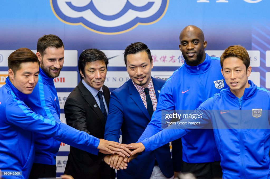 Kitchee FC Head Coach Alex Chu (3L-R) and Wilson Ng, Kitchee General Manager (4L-R) introduces his new soccer players Ju Ying-zhi, Josip Tadic, Mohamed Sissoko and Yuto Nakamura during the press conference on July 12, 2018 in Hong Kong.