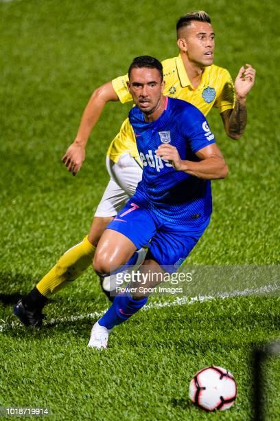 Kitchee Forward Fernando Azevedo Pedreira in action against Javier Patino Lachica of Buriram during the Preseason Friendly Match between Kitchee and...