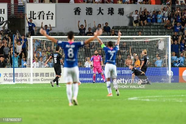 Kitchee's teamplayers celebrate with fans after scoring a goal during the friendly football match between English Premier League club Manchester City...