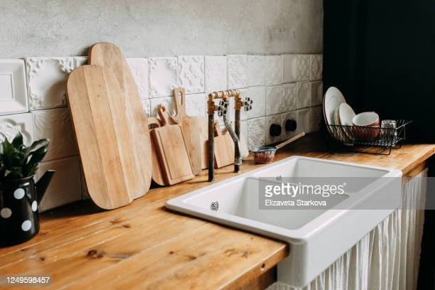 kitchen accessories and utensils, dark cozy interior of the kitchen at home - kitchen worktop stock pictures, royalty-free photos & images