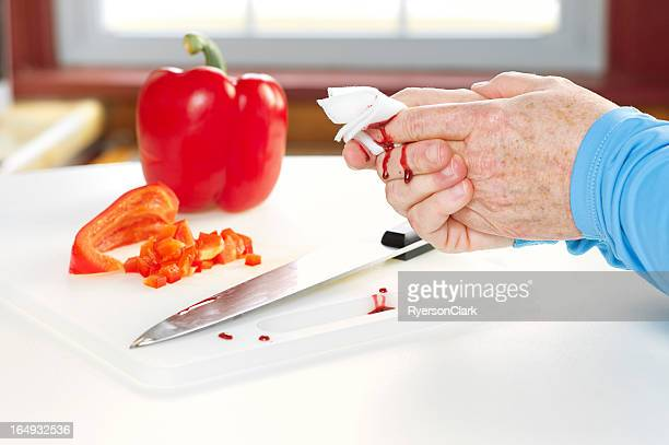 kitchen accident with knife and blood - wounded stock photos and pictures