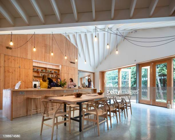 Kitchen and dining area. Maggie's Centre at Velindre Hospital, Cardiff, United Kingdom. Architect: Dow Jones Architects, 2019.