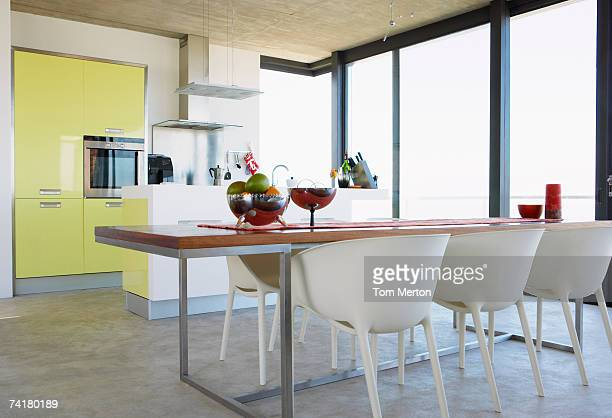 kitchen and dining room with large window - big tom stock pictures, royalty-free photos & images