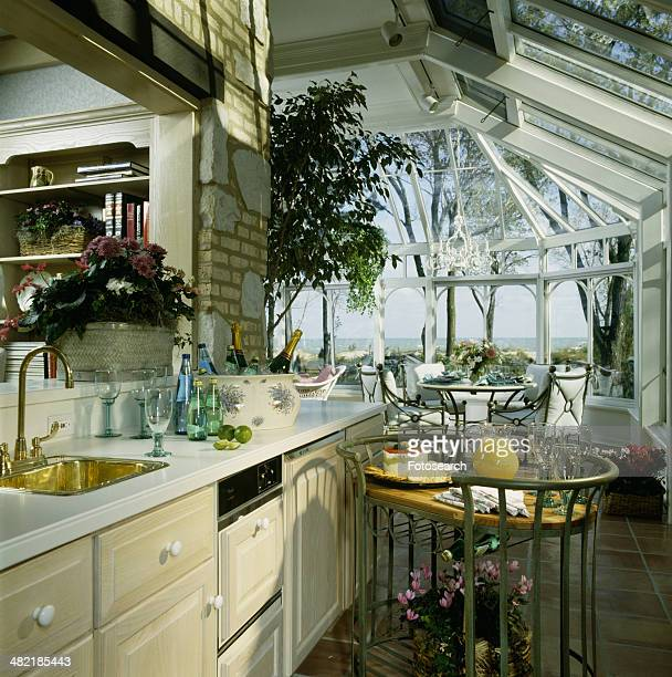 Kitchen and eating area in solarium,