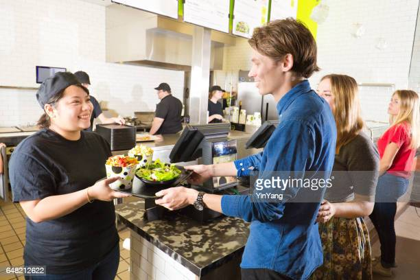 Kitchen and Wait Staff Serving Customers in Fast Food Restaurant