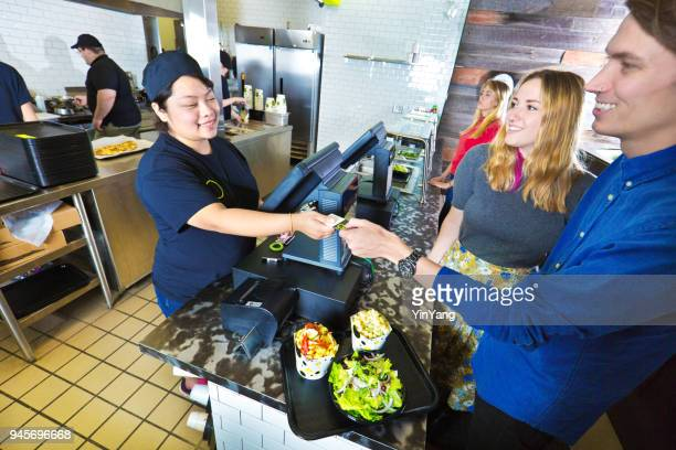 Kitchen and Wait Staff Serving Customers in Fast Food Restaurant Checkout